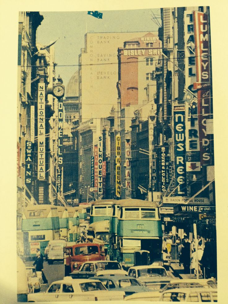 Cars and buses together, negotiating busy George Street Sydney in 1964.