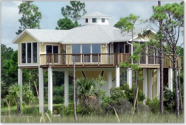 Hurricane proof elevated piling stilt home built 15 ft for Lake house plans on stilts
