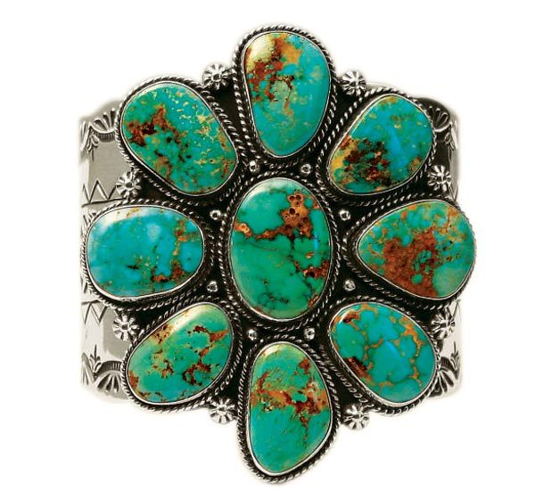 Silver and turquoise bracelet. I love the vibrant yellows and oranges in these particular stones.
