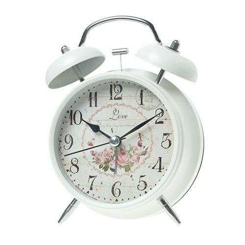 Αν το πρωί πρέπει να ξυπνάμε, ας γίνεται αυτό όμορφα, με ένα ξυπνητήρι ρετρώ, λευκό μεταλλικό με ροζ τριαντάφυλλα.