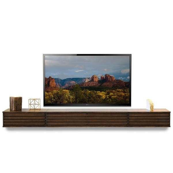 PRE-ORDER. SHIPS IN APPROXIMATELY 2 to 3 WEEKS Floating TV Stand Wall Mount Entertainment Center Save $$ With Bundle! The Lotus Floating Console has been meti
