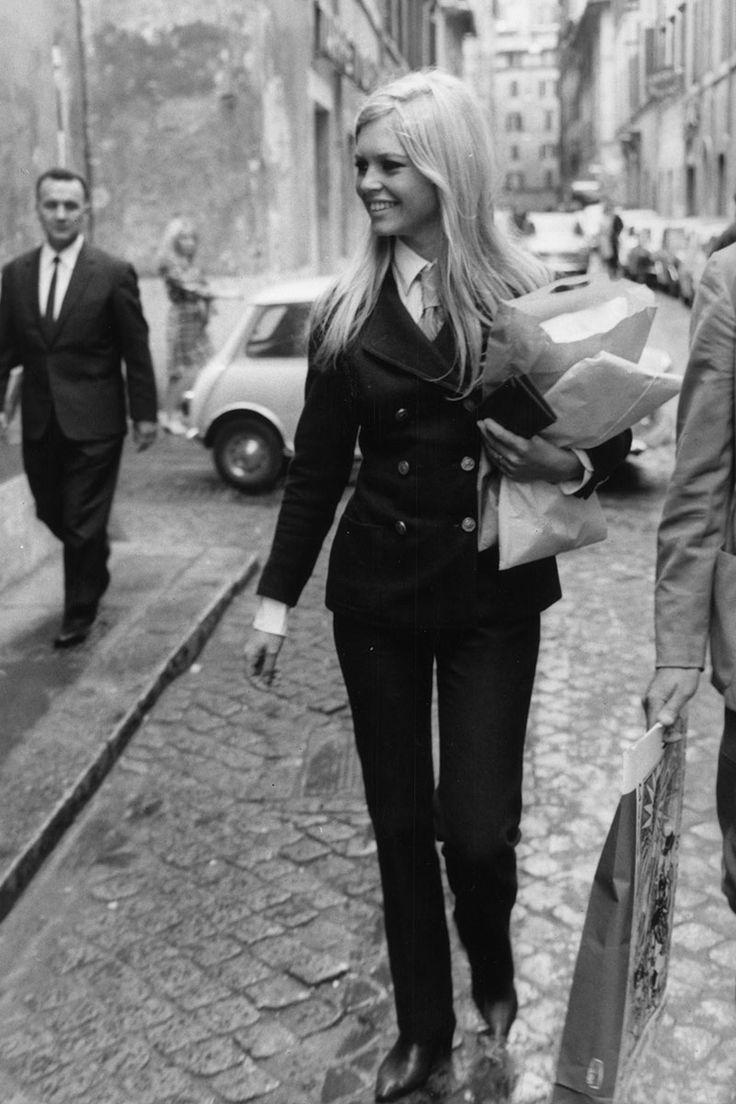 Brigitte Bardot goes shopping in the Via Margutta in Rome in 1961 wearing a sleek trouser suit