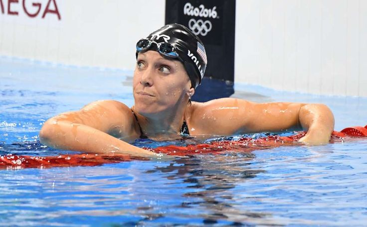 Olympic swimmer Dana Vollmer's tart, honest take on pregnancy  -  August 8, 2016  -      Dana Vollmer looks at the clock after winning bronze in the 100-meter butterfly during the swimming finals at the Rio Olympic Stadium on Aug. 7 in Rio De Janeiro.