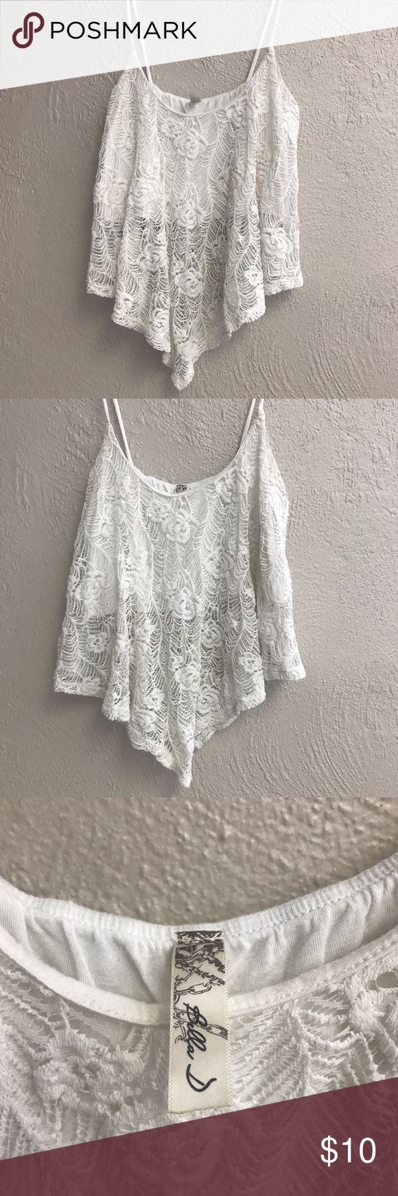 White lacey crop top Super cute lace crop top with bra insert and low hanging in front Tops Crop Tops