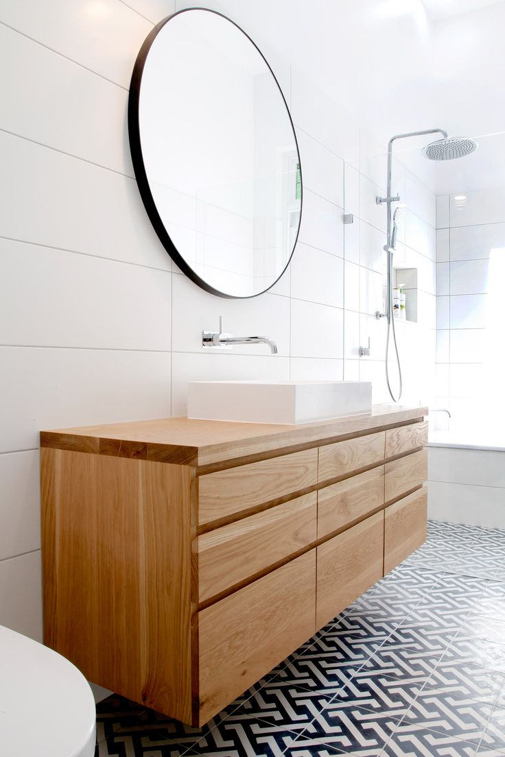 The Ballina American Oak floating timber vanity by Bombora Custom Furniture, Victoria, Australia.  This light brown toned vanity is created from solid timber with lots of storage drawers.