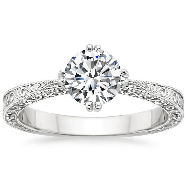 18K White Gold True Heart Ring from Brilliant Earth like how it bows in to enphasize the diamond