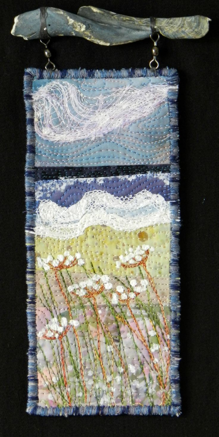 Queen Anne.  Small art quilt beach scene hanging from found shell fragment by Eileen Williams