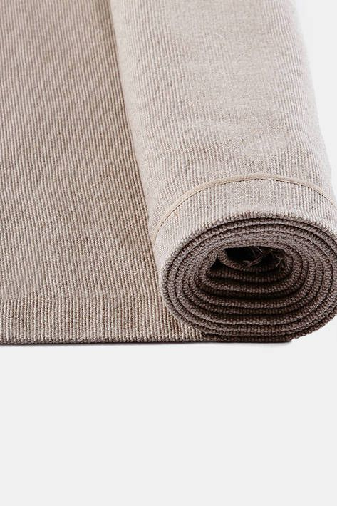 Pull together any room with a rug of pure linen in a warm neutral hue. Woven in a subtle rib and finished with a gentle fringe, this generously sized Belgian linen rug from Libeco carries an international trademark that attests to its composition (at least 85% by weight of natural flax fibers of European origin) and quality.
