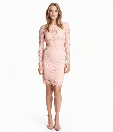 Fitted, long-sleeved dress in stretch lace with V-neck at back and seam at waist. Partly lined in jersey.