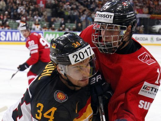 Germany defender Benedikt Kohl, left, struggles with Switzerland forward Kevin Fiala during the Group B preliminary round match between Germany and Switzerland at the Ice Hockey World Championship in Minsk, Belarus, on May 14, 2014.