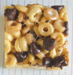 Peanut Butter Cheerios Treats  INGREDIENTS: 6 cups Cheerios, 2 tbsp butter, 1/3 cup smooth peanut butter, 40 marshmallows, 1 cup chocolate chips, 9x13 baking pan, cooking spray.