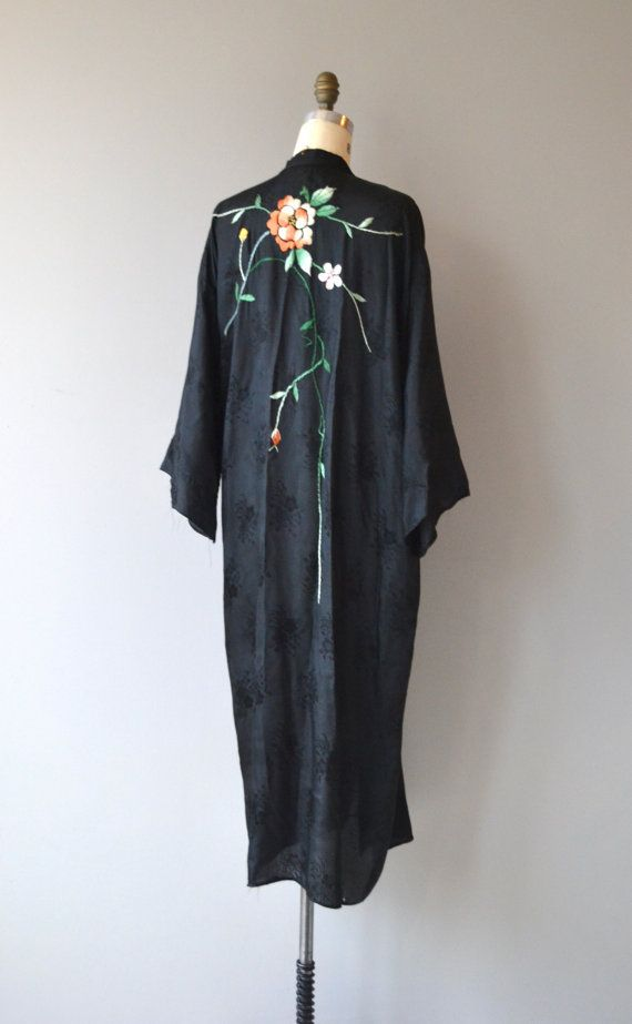 Vintage 1950s black rayon blend embossed wrapper robe with floral embroidery at shoulder and upper back. ✂-----Measurements  fits like: fits most bust: free waist: free length: 50 brand/maker: n/a condition: excellent  to ensure a good fit, please read the sizing guide: http://www.etsy.com/shop/DearGolden/policy  ✩ visit the shop ✩ http://www.DearGoldenVintage.etsy.com