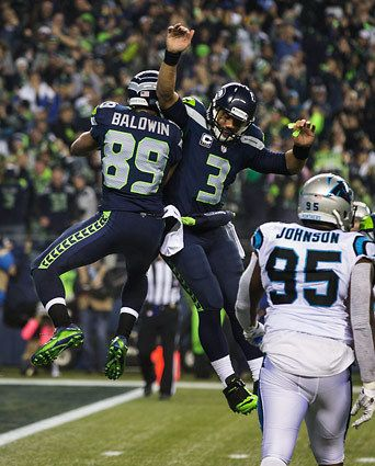 Seahawks wide receiver Doug Baldwin (89) and Seahawks quarterback Russell Wilson (3) celebrate after Baldwin's touchdown during first-half action. (Photo by Mike Siegel / The Seattle Times)