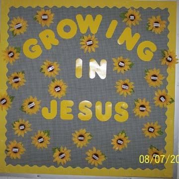 sunday school bulletin boards | Bulletin Board Idea flowers with pictures in the middle