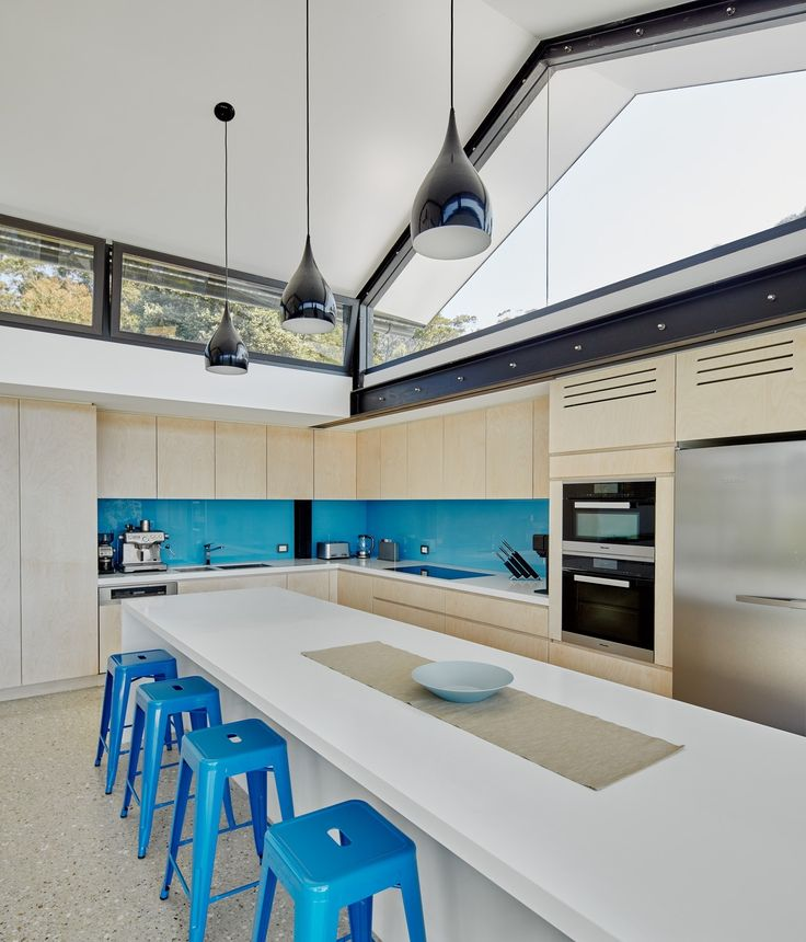 High windows provide ample lighting during the day for the kitchen and dining areas