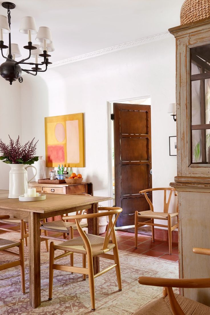 Reese Witherspoon's House in Home Again Movie. Dining room with Danish wishbone or Y chairs in Reese Witherspoon's Spanish hacienda House in Home Again Movie. #diningroom #homeagain #midcenturymodern #wishbonechair #interiordesign #homeagain