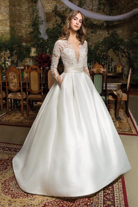 Cosmobella – Wedding Dress – 7950 Exquisite lace embellishes the bodice and striking back of this timeless Mikado gown featuring a V-neckline, long lace sleeves and Luxurious A-line skirt with box pleats and pockets. Also Available in Satin Shown: Ivory/Natural Wedding Gown, Bride, Bridal Gown, Bridal Dress