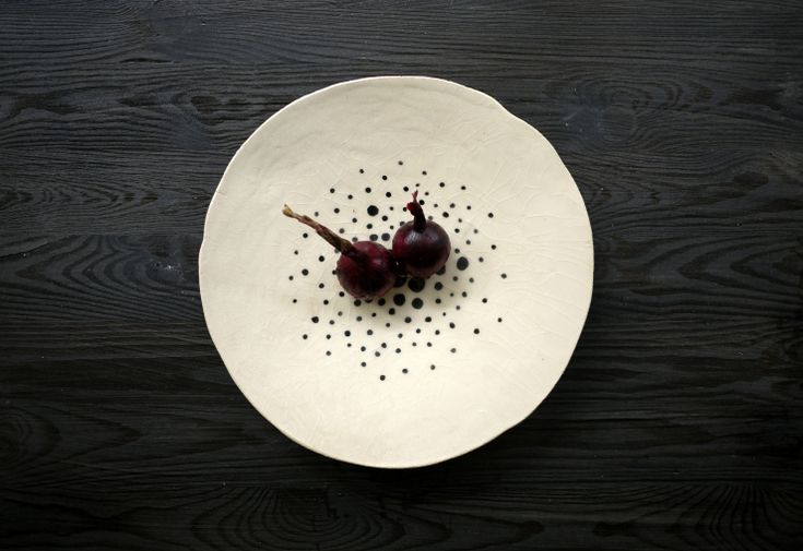 Red onions  presented on a Simply Dots ceramic plates series by Projectorium. Black and white decoration for your table or at your kitchen.