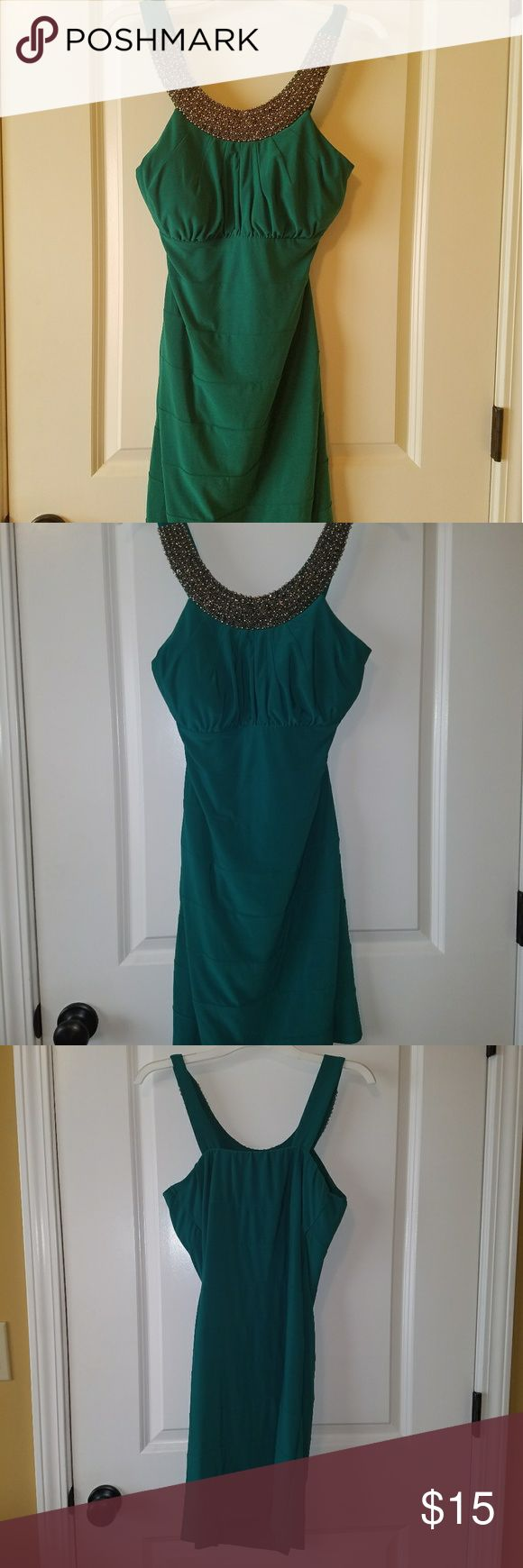 Emerald green cocktail dress Vibrant green with pewter accent around neckline. Worn once Dresses