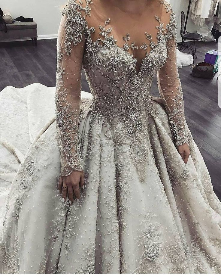 This intricate long sleeve wedding gown was created with a plethora of hand beading and jewels.  Haute couture #weddingdresses like this do not have to cost a fortune.  We are in the USA and can help you get a couture style & look like this for less.  We specialize in custom designs as well as #replicas of haute couture gowns that will look similar but cost less than the original.  For pricing and more info on how the process works email us directly.  DariusCordell.com