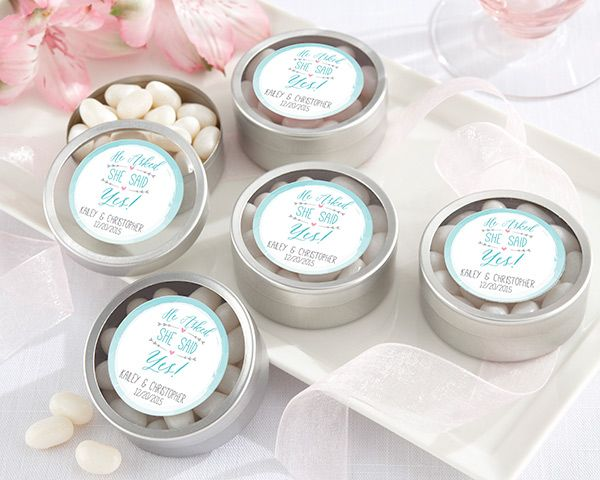 Fill these personalized round candy tins from Kate Aspen with handmade treats or other items for a bridal shower or engagement party favor guests will enjoy.
