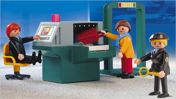 Playmobil toys depict real-life settings, and not always cheery ones, like a police station, hospital and animal clinic. But one, the Security Check Point, took that philosophy too far for some parents.    The set — which includes armed airport security officers, a metal detector and an X-ray screening machine
