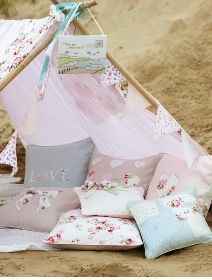 I love this play tent -  so simple to make. I am currently doing  similar thing for my 3.Love the bunting and cushions. Almost exactly as I would make my own. (A bit less 'fluffy')!