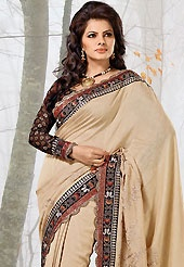 Envelope yourself in classic look with this charming saree. This fawn raw silk saree have beautiful embroidery patch work which is embellished with resham, zari, sequins and lace work. Fabulous designed embroidery gives you an ethnic look and increasing your beauty. Contrasting black viscose blouse is available. Slight Color variations are possible due to differing screen and photograph resolutions.