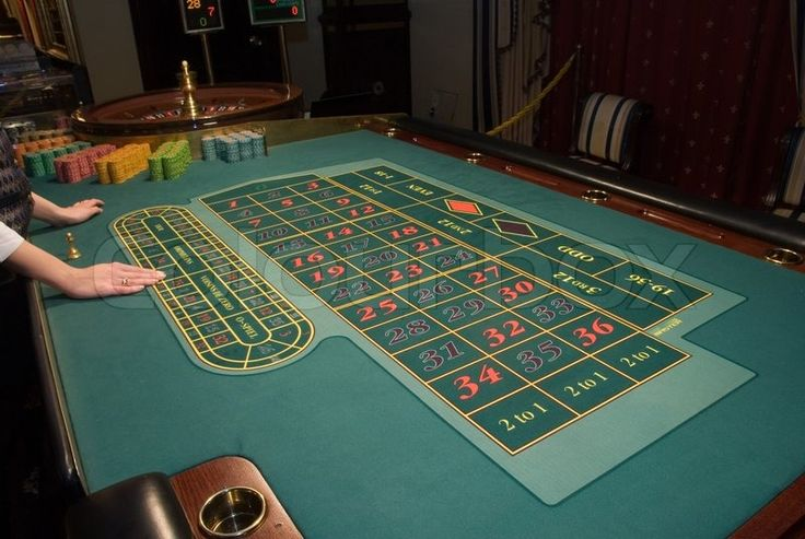 Stock image of 'Close-up view of roulette table in modern casino'
