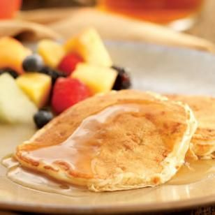 Apple-Bacon Pancakes with Cider Syrup Recipe...****4.5 Rating....  If you like apple pancakes and you like bacon, you'll love the taste of these sweet, smoky pancakes. Any kind of apple works well. A quick cider syrup drizzled on top enhances the apple flavor.