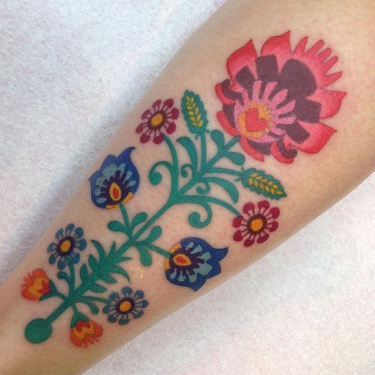 The colors + design of this floral embroidery tattoo are stunning!