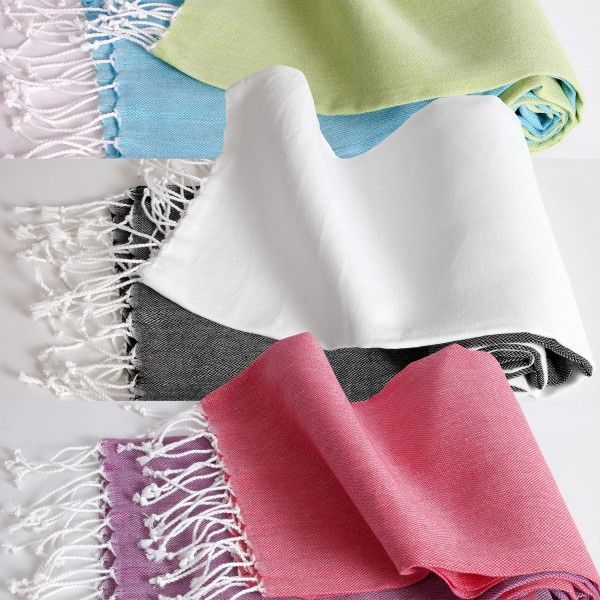 Natural Turkish bath towels in constractin colors.