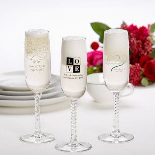 Cheers to a wonderful wedding – and personalized champagne flutes! Elegant glass flutes are decorated with a long twisted stem, and finished with a beautiful silkscreened design of your choice.