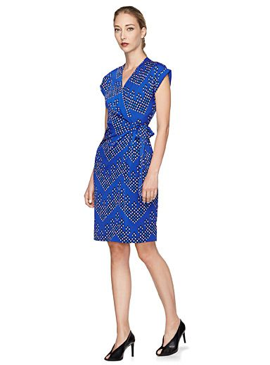 DVF dresses are your go-to for elegantly modern looks, and this piece is no exception. Made in a silky material with a highly feminine silhouette and an electric blue hue accentuated by colourful dotted chevrons, it needs nothing more to enhance your natural beauty.    Light and fluid stretch silk weave, unlined   Wrap dress-inspired crossover bodice with a ribbon that ties at the waist    The model is wearing size 6    Length: 100cm, from the top of the shoulder