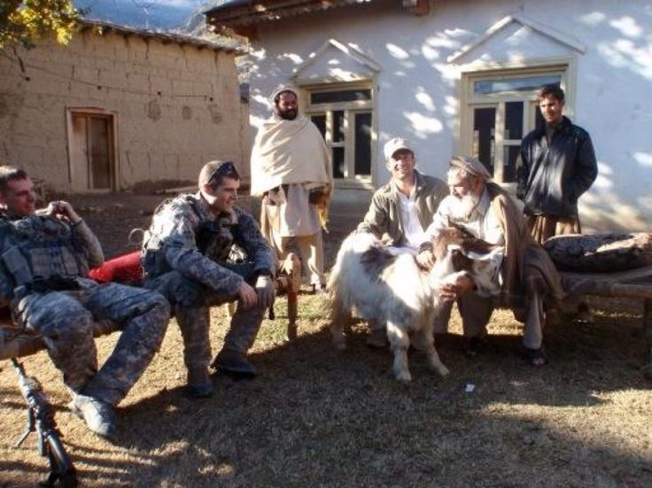 @troopsincontact: #tbt Giving out goat gifts for Eid, 2009.