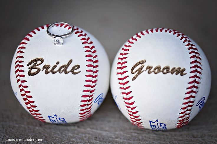 bride and groom engraved baseballs. Have your engagement photos done at a place that you're passionate about. Baseball engagement photos  www.amesweddings.ca Copyright Ames Photography 2015