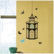 "Bird Cage Appliques    Dimensions: 1 sheet of 40"" x 18"" - 23 Decals    Create sophistication in seconds with this whimsical yet classic birdcage peel and stick design with a twist. The cage comes with two sets of birds and butterflies (monochrome and multi-coloured). Use one or the other, depending on the mood you want to create... or use both at the same time! Set the elements inside or outside the over-sized cage. Change as you like."