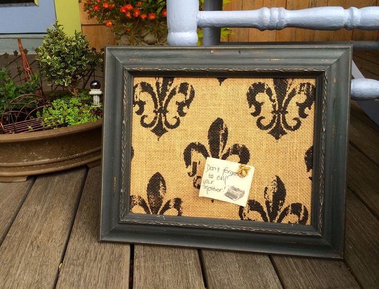 Frame redo.  Bulletin board covered with stenciled burlap purchased at Joann Fabrics.  Frame painted with Annie Sloan Chalk Paint Graphite covered with dark wax.  Light touch of gilding wax to top it off.
