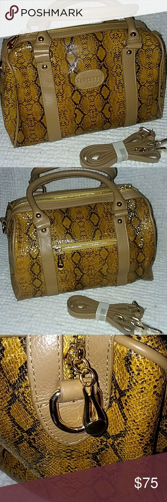 """Terzetto leather snack skin satchel NWOT Dial top rolled handles - Detachable adjustable shoulder strap - Top zip closure - Snakeskin printed exterior - Exterior features contrast inset front panels and back zip pocket - Interior features zip wall pocket and 2 media wall pockets - Fully lined - Approx. 8"""" H x 12"""" W x 5"""" D - Approx. 10"""" handle drop, 22"""" strap drop - ImportedMaterialsGenuine cow hide leather exterior, cotton liningCareWipe with damp cloth Terzetto Bags Satchels"""