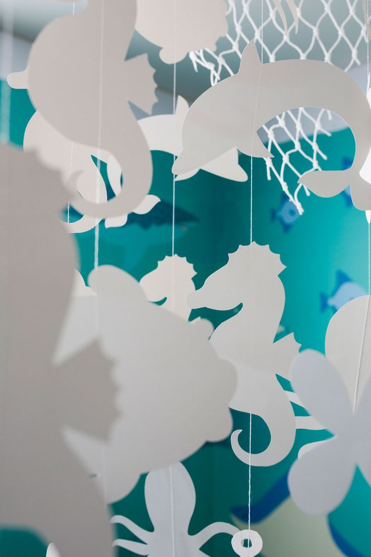 #decorationforchildrensroom #playrooms #underthesea #oceanroom #readingcorner #mobiles #design #rope #seahorse #dolphins #octopus Handmade mobile suspended in children's playroom.
