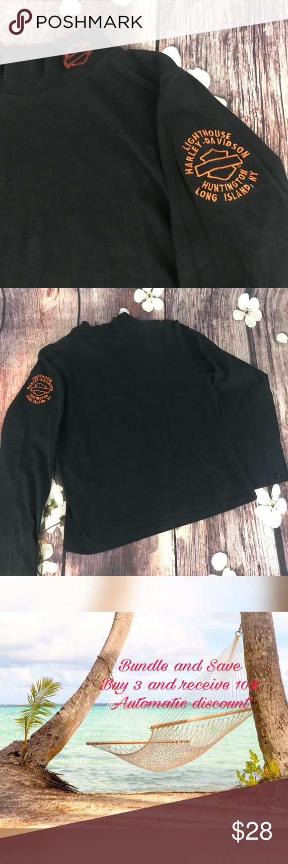 """Harley Davidson Ladies Top Black long sleeve Harley Davidson top with a high neck with a small logo embroidered on it and a dealership logo embroidered on the sleeve.  This one is from Lighthouse Harley Davidson, Huntington, Long Island, NY.  Material 100% cotton.  Measurements: pit to pit approx 40"""" length approx 21"""".   Size L (check measurements - may run small) Orig $.    Now $ Harley-Davidson Tops Tees - Long Sleeve"""
