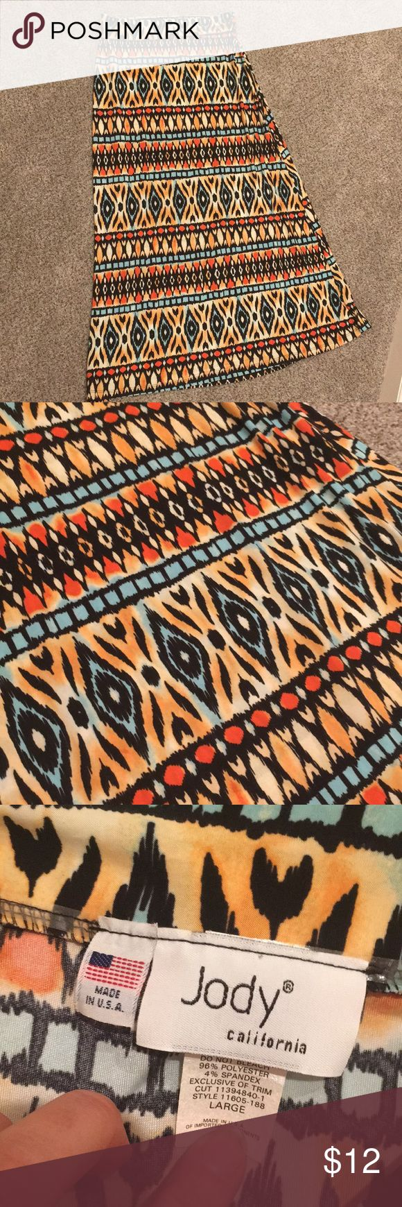 Tribal maxi skirt size large Adorable tribal print maxi skirt size large. Smoke free clean home fold over waist band lots of stretch excellent condition. 40 inches in length Jody Skirts Maxi