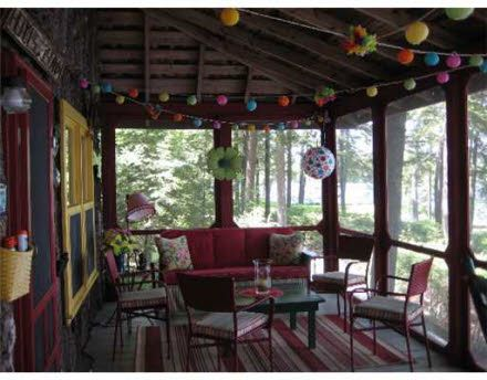 screened in porch - rug and lights, fun bright colors