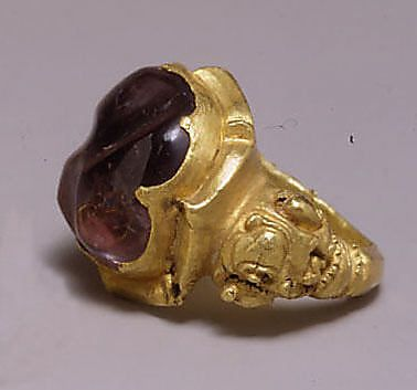 Ring with Large Purple Stone in Oval Mount  Period: Central Javanese period Date: 8th–early 10th century Culture: Indonesia (Java) Medium: Gold with purple stone