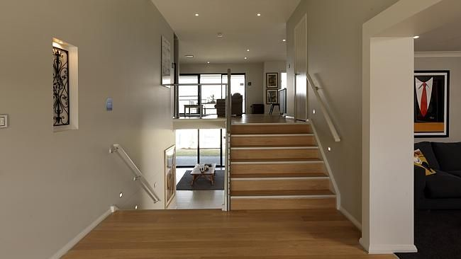The entry foyer shows the two distinct levels.