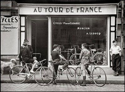 Robert Capa. Le tour de France,  Le magasin de cycles de Pierre Cloarec a Quimpe, 1939.