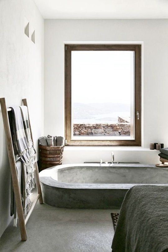 great use of a ladder to hang towels in the bathroom - great view too! - The World's Most Beautiful Bathtubs