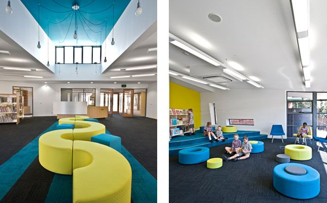 Cool Elementary Library with Blue Color Dominant - like the dark blue carpet;  love the curvy and round flexible seating