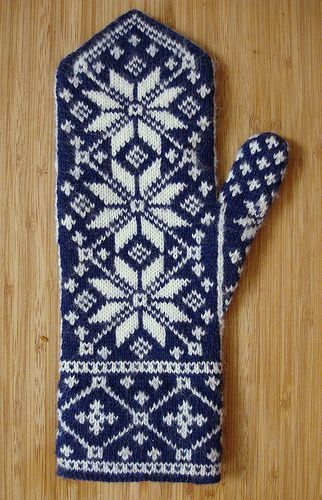 These intricately-patterned mittens are a riff on an old Norwegian rose motif. The cuff edge is finished with a wide turned hem, and the back of the hand showcases three interconnected stars. The palm side has a simpler colorwork pattern, and the thumb gusset features a smaller version of the star.