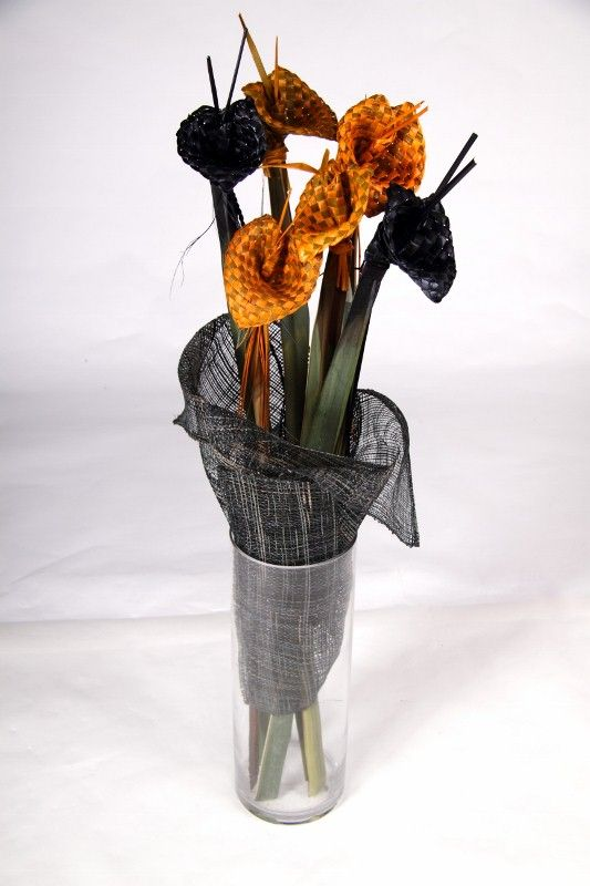 Vase of yellow & black flax woven flowers - creation of Forever Flax